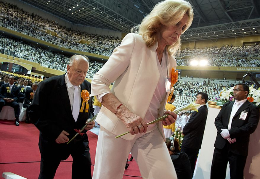 Dignitaries and honored guests, including Graciela Rompani de Pacheco, right, former first lady of Uruguay, were invited to offer flowers before a portrait of the late Rev. Sun Myung Moon during his funeral in Gapyeong, Korea on Saturday, Sept. 15, 2012. (Barbara L. Salisbury/The Washington Times)