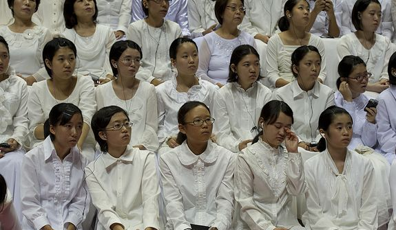 Women and girls with the Korea-Japan United Chorus wait to perform at the funeral service for the late Rev. Sun Myung Moon at the Cheong Shim Peace World Center in Gapyeong, Korea on Saturday, Sept. 15, 2012. (Barbara L. Salisbury/The Washington Times)