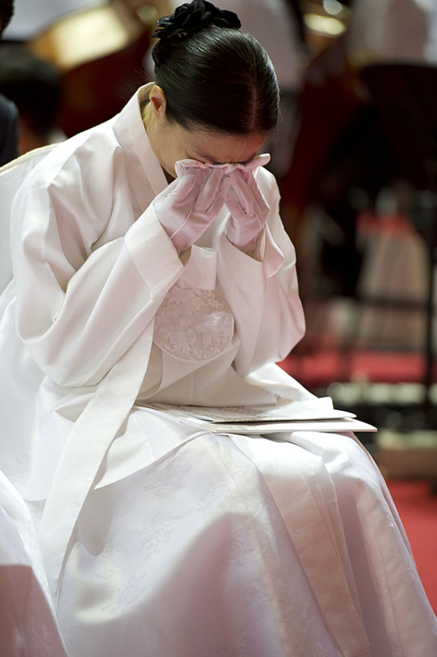 A family member of the late Rev. Sun Myung Moon cries during the Seonghwa, or ascension, ceremony, for the reverend at the Cheong Shim Peace World Center in Gapyeong, Korea on Saturday, Sept. 15, 2012. (Barbara L. Salisbury/The Washington Times)