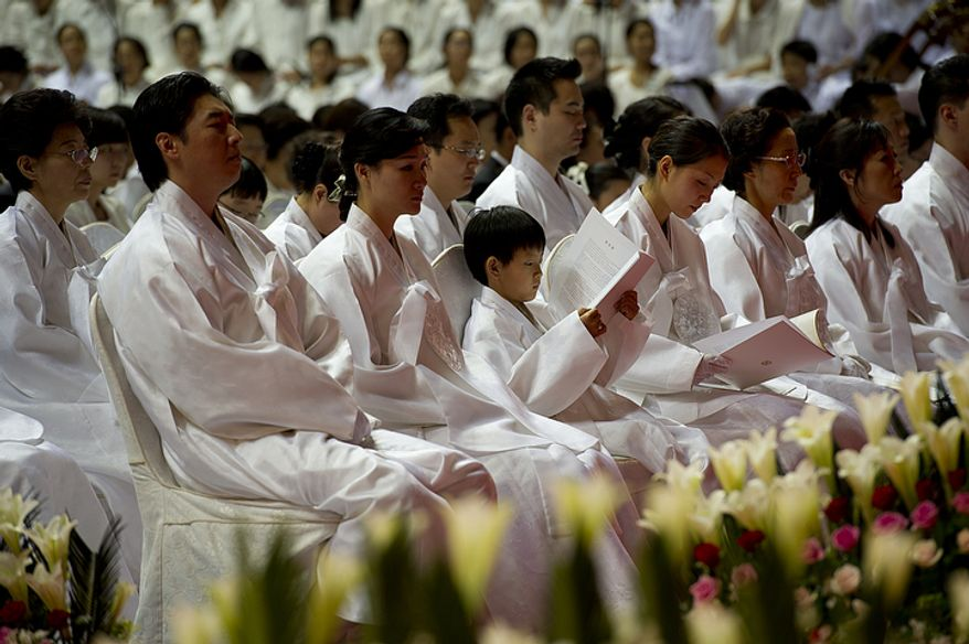Family members of the late Rev. Sun Myung Moon sit in the front row during his funeral, held at the Cheong Shim Peace World Center in Gapyeong, Korea on Saturday, Sept. 15, 2012. (Barbara L. Salisbury/The Washington Times)