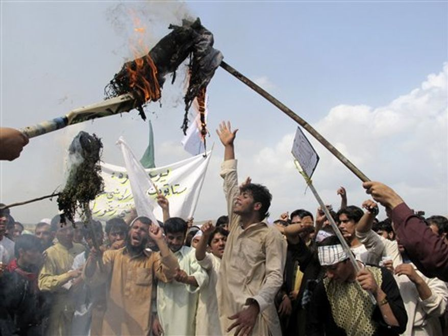 "Afghans burn an effigy of U.S. President Barack Obama during a protest in Khost, south-east of Kabul, Afghanistan, Saturday, Sept. 15, 2012. A few hundred of university students protested against an anti-Islam film which depicts the Prophet Muhammad as a fraud, a womanizer and a madman, in Khost, shouting ""death to America."" (AP Photo/Nashanuddin Khan)"