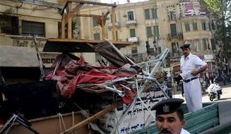 Egyptian police load furniture and other items confiscated from street vendors as they clear Tahrir Square in Cairo, Egypt, Saturday, Sept. 15, 2012, after days of protests near the U.S. embassy over a film insulting Prophet Muhammad. (AP Photo/Mohammed Asad)
