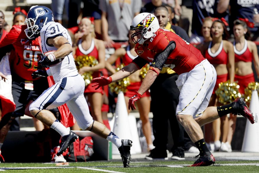 Connecticut wide receiver Nick Williams, left, outruns Maryland's Matt Furstenburg for a touchdown on a punt return in the first half of an NCAA college football game in College Park, Md., Saturday, Sept. 15, 2012. (AP Photo/Patrick Semansky)