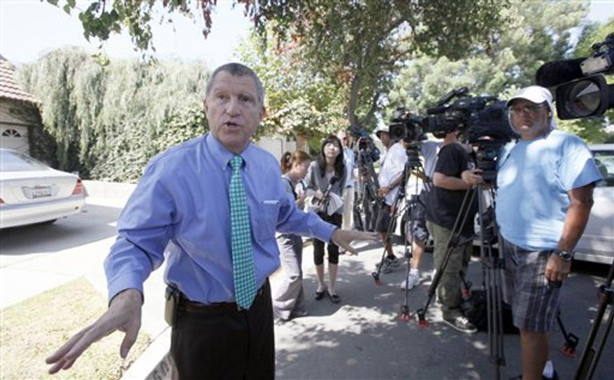 "Los Angeles Sheriff's Department spokesman Steve Whitmore speaks to media outside the home of Nakoula Basseley Nakoula on Thursday, Sept. 13, 2012, in Cerritos, Calif. Nakoula, has said that he helped with logistics for the filming of ""Innocence of Muslims,"" which mocked Muslims and the prophet Muhammad and may have inflamed mobs that attacked U.S. missions in Egypt and Libya. (AP Photo/Nick Ut)"