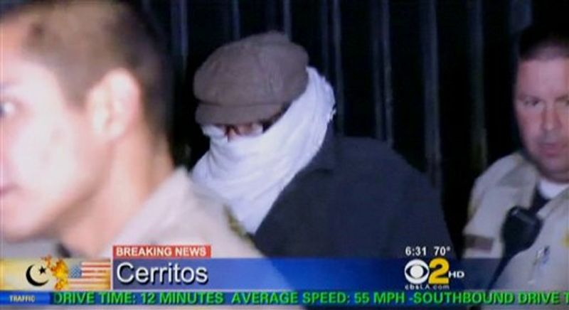 In this image from video provided by CBS2-KCAL9, Nakoula Basseley Nakoula, the man behind the anti-Muslim movie that has inflamed the Middle East, is escorted by Los Angeles County sheriff's deputies from his home, early Saturday, Sept. 15, 2012, in Cerritos, Calif. Nakoula, 55, was interviewed by federal probation officers at a Los Angeles sheriff's station but was not arrested or detained, authorities said early Saturday. (AP Photo/CBS2-KCAL9)