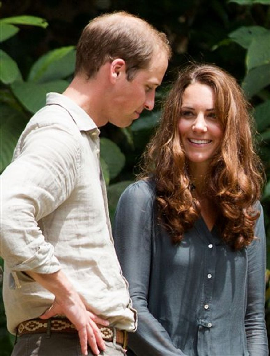 Britain's Prince William, left, and Kate, the Duchess of Cambridge, speak to each other during their visit at the Borneo Rainforest Lodge in Danum Valley, some 70 kilometers (44 miles) west of Lahad Datu, on the island of Borneo on Saturday, Sept. 15, 2012. (AP Photo/Mohd Rasfan, Pool)