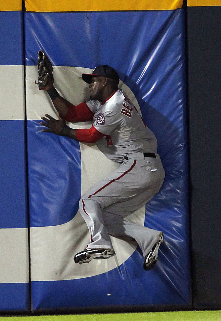 Roger Bernadina was OK after slamming into the left field wall at Turner Field Friday night making a catch. (Associated Press)