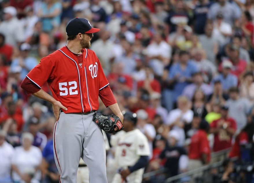 Washington Nationals relief pitcher Ryan Mattheus pauses after hitting the uniform of an Atlanta Braves batter with the bases loaded, scoring Jeff Baker with the go-ahead run in the eighth inning of a baseball game Saturday, Sept. 15, 2012, in Atlanta. The Braves won 5-4. (AP Photo/David Tulis)