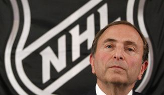 NHL commissioner Gary Bettman listens as he meets with reporters after a meeting with team owners, Thursday, Sept. 13, 2012 in New York. The current collective bargaining agreement between the league and the players expires Saturday at midnight. (AP Photo/Mary Altaffer)