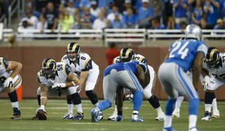 St. Louis Rams quarterback Sam Bradford (8) gets set under center Robert Turner (59) during an NFL game against the Detroit Lions in Detroit, Sunday, Sept, 9, 2012. (AP Photo/Rick Osentoski)