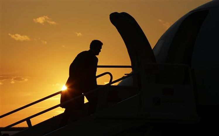 Republican presidential candidate and former Massachusetts Gov. Mitt Romney is seen in silhouette as he boards his campaign charter plane while the sun sets in Cleveland, Ohio, Friday, Sept. 14, 2012, after holding a campaign rally and fundraising events. (AP Photo/Charles Dharapak)