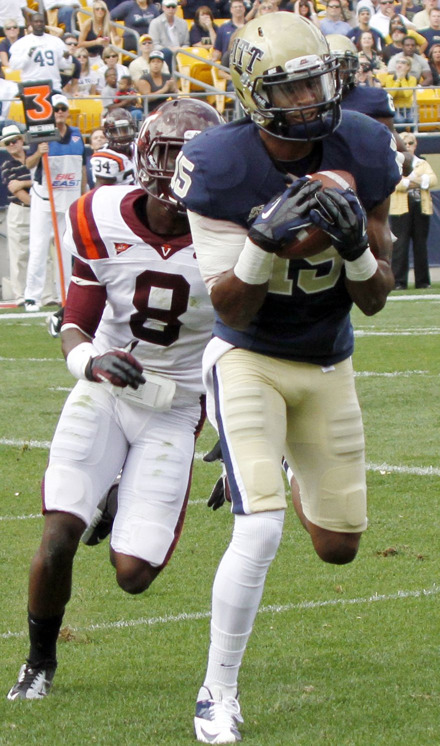 Pittsburgh wide receiver Devin Street (15) catches a pass for a touchdown in front of Virginia Tech safety Detrick Bonner (8) in the first quarter of their NCAA college football game, Saturday, Sept. 15, 2012, in Pittsburgh. Pittsburgh won 35-17. (AP Photo/Keith Srakocic)