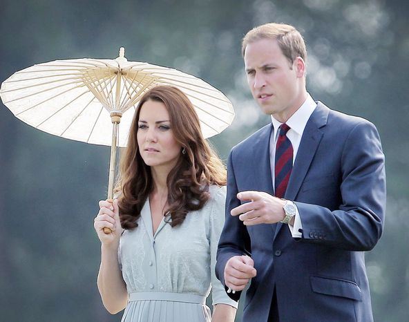 Prince William and his wife Kate Middleton pay their respects to the war dead of both World War I and World War II in Singapore on Thursday, not long after photographs of the Duchess of Cambridge sunbathing topless were published in a French magazine. The incident is reminiscent of the worst excesses of the press and paparazzi during the life of Princess Diana, a St. James Palace official said. (Associated Press)