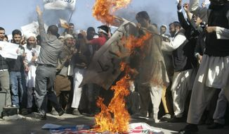 Afghans burn the U.S. flag in Herat, Afghanistan, on Sunday, Sept. 16, 2012, during a protest against an Internet video mocking the Prophet Muhammad that many fear could further aggravate Afghan-U.S. relations. (AP Photo/Hoshang Hashimi)