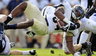 Navy fullback Noah Copeland (34) is stopped by Penn State linebackers Mike Hull, left, and Michael Mauti, right rear, during the second quarter of an NCAA college football game in State College, Pa., Saturday, Sept. 15, 2012. (AP Photo/Gene J. Puskar)