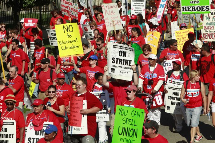 Striking schoolteachers march after a rally on Saturday, Sept. 15, 2012,