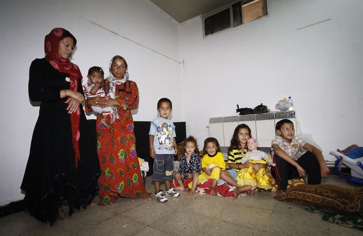Syrians who fled their homes because of fighting between Syrian rebels and government forces, take refuge at the Samiya al-Makhzumi School in the Mezzeh neighborhood of Damascus, Syria, on Sunday, Sept. 16, 2012. (AP Photo/Muzaffar Salman)