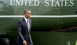 President Obama walks to the Oval Office of the White House in Washington on Sept. 14, 2012, after arriving on Marine One on the South Lawn. (Associated Press)