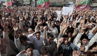 Supporters of the Pakistani Tehreek-e-Insaf, or Movement for Justice, chant slogans during a demonstration in Peshawar, Pakistan, on Sunday, Sept. 16, 2012, as part of widespread anger across the Muslim world about a film ridiculing Islam's Prophet Muhammad. (AP Photo/Muhammad Sajjad)