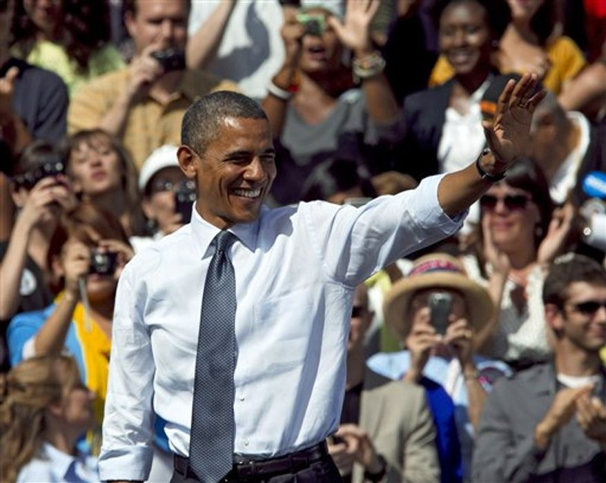 In this Sept. 13, 2012, photo, President Obama waves after speaking at a campaign rally in Golden, Colo. Obama and Republican Mitt Romney are embarking on a week heavy with travel through battleground states and appeals key constituencies, with both campaigns wrangling over unrest in the Middle East and who is best equipped to rejuvenate the economy. (AP Photo/Ed Andrieski)