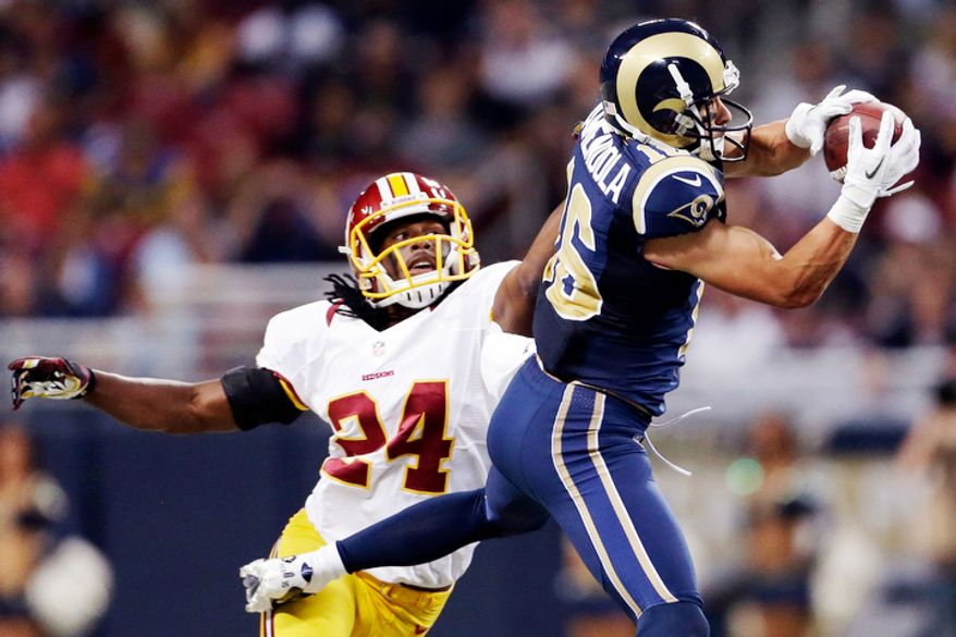 St. Louis Rams wide receiver Danny Amendola, right, catches a pass as Washington Redskins strong safety DeJon Gomes defends during the first quarter. (AP Photo/Jeff Roberson)