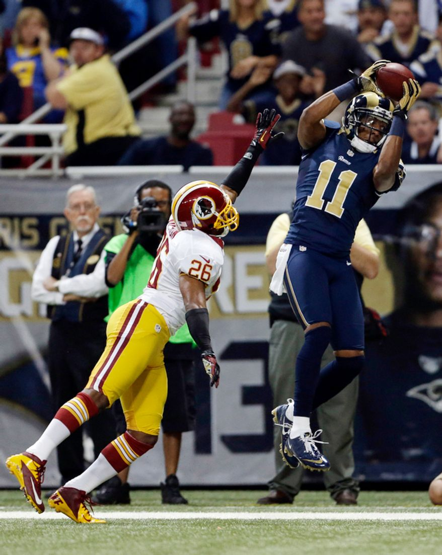 St. Louis Rams wide receiver Brandon Gibson, right, catches a pass as Washington Redskins cornerback Josh Wilson defends during the first quarter. Gibson was ruled out of bounds on the play. (AP Photo/Jeff Roberson)