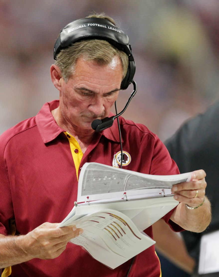 Washington Redskins head coach Mike Shanahan roams the sidelines during the second quarter. (AP Photo/Tom Gannam)