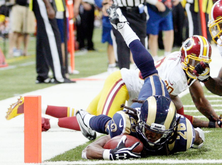 St. Louis Rams running back Daryl Richardson, front, runs the ball down to the 1-yard line as Washington Redskins defensive back Cedric Griffin, rear, looks on during the third quarter. (AP Photo/Tom Gannam)