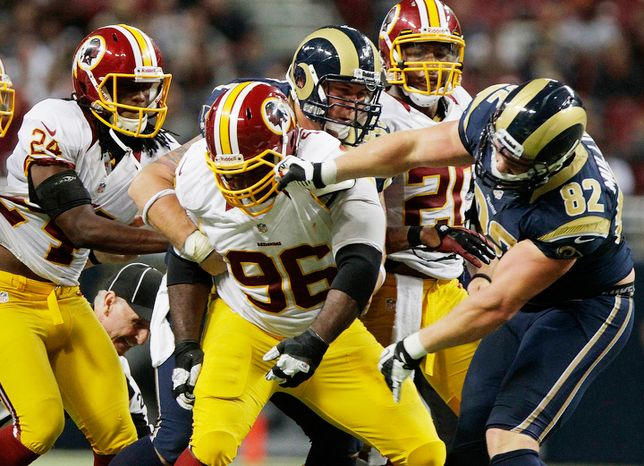 Washington Redskins nose tackle Barry Cofield (96) and St. Louis Rams tight end Matthew Mulligan scuffle during the fourth quarter 8. (AP Photo/Seth Perlman)