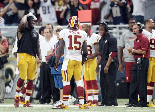 The Washington Redskins sideline including head coach Mike Shanahan, right, reacts after wide receiver Joshua Morgan (15) picked up an unsportsmanlike conduct penalty for throwing the ball at an opposing player during the fourth quarter action against the St. Louis Rams in an NFL football game on Sunday, Sept. 16, 2012 at the Edward Jones Dome in St. Louis. (AP Photo/St. Louis Post-Dispatch, Chris Lee)