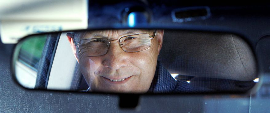 Jerry Wiseman is reflected in the rearview mirror, in Schaumburg, Ill. Mr. Wiseman and his wife, Sandy, took refresher driving classes to help them stay safe behind the wheel for many more years. Mr. Wiseman learned exercises to improve his flexibility for checking blind spots when turning. He takes extra care with left-hand turns, which become riskier as the ability to judge speed and distance wanes with age. Thirty states and the District of Columbia have special requirements for older drivers. (Associated Press)