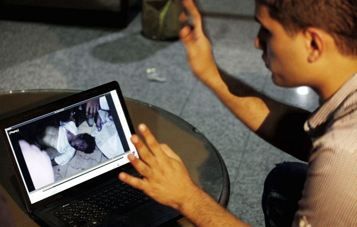 Fahd al-Bakoush shows a video he took of U.S. Ambassador J. Christopher Stevens from the consulate in Benghazi, Libya. (Associated Press)