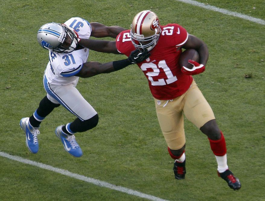 San Francisco 49ers running back Frank Gore, right, carries the ball past Detroit Lions defensive back Drayton Florence, left, during the second quarter of an NFL football game in San Francisco, Sunday, Sept. 16, 2012. (AP Photo/Tony Avelar)