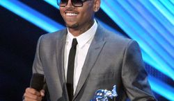 "R&B singer Chris Brown accepts the award for best male video for ""Turn Up the Music"" at the MTV Video Music Awards in Los Angeles on Thursday, Sept. 6, 2012. (AP Photo/Matt Sayles, Invision)"
