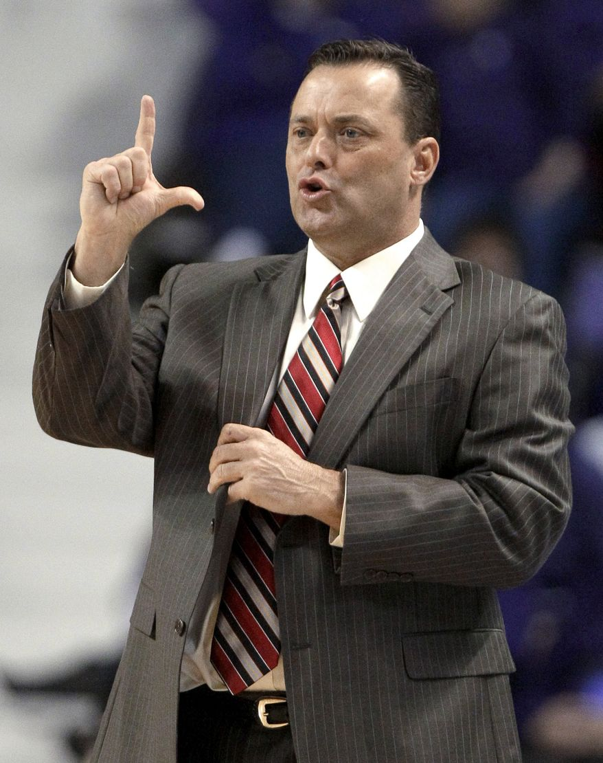 """FILE - This Feb. 7, 2012 file photo shows Texas Tech coach Billy Gillispie gesturing to his team during the first half of a college basketball game against Kansas State, in Manhattan, Kan. The Texas Tech athletic director says coach Gillispie is no longer making day-to-day decisions for the basketball program so he can focus on his health. Kirby Hocutt said Tuesday, Sept. 11, 2012,  that he told Gillispie late last week that he was not """"to engage"""" in the program in """"any way"""" until the two talk face to face about allegations of player mistreatment. (AP Photo/Charlie Riedel, File)"""
