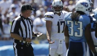 San Diego Chargers quarterback Philip Rivers talks with an official while playing the Tennessee Titans during the first quarter of an NFL football game Sunday, Sept. 16, 2012, in San Diego. (AP Photo/Lenny Ignelzi)