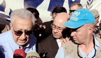 Lakhdar Brahimi (left), the U.N.-Arab League envoy to Syria, speaks in Mafraq, Jordan, on Tuesday as Andrew Harper, the UNHCR representative to Jordan, listens during a visit to the Zaatari refugee camp for Syrians who fled the civil war. (Associated Press)