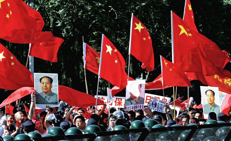 Protesters march outside the Japanese Embassy in Beijing on Tuesday. The 81st anniversary of a Japanese invasion brought a fresh wave of anti-Japan demonstrations, with thousands venting anger over the colonial past and a current dispute involving contested islands in the East China Sea. (Associated Press)