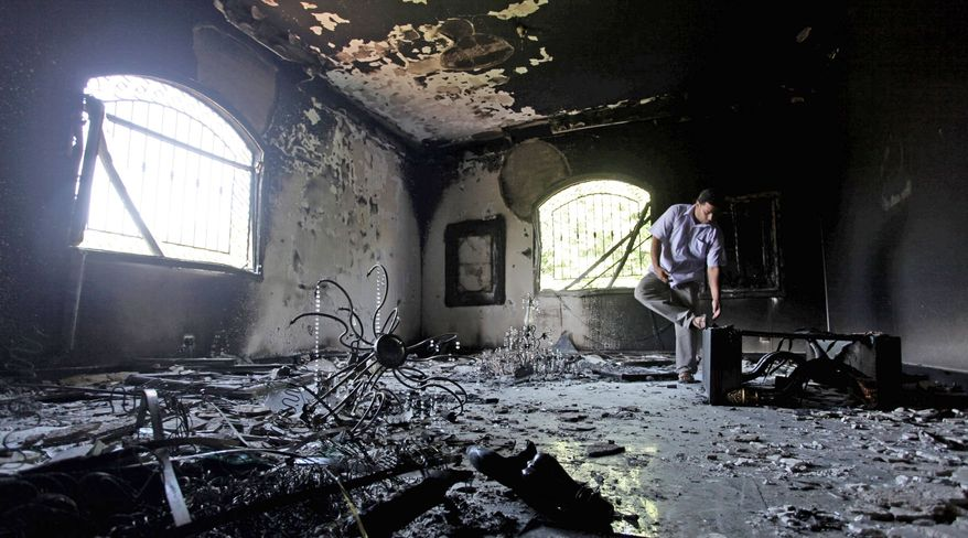 ** FILE ** A Libyan man investigates the inside of the U.S. Consulate in Benghazi after the attack that killed Ambassador J. Christopher Stevens and three other Americans on Tuesday, Sept. 11, 2012. (Associated Press)