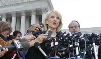 "**FILE** Arizona Gov. Jan Brewer speaks April 25, 2012, to reporters in front of the Supreme Court in Washington after the high court questioned Arizona's ""show me your papers"" immigration law. (Associated Press)"