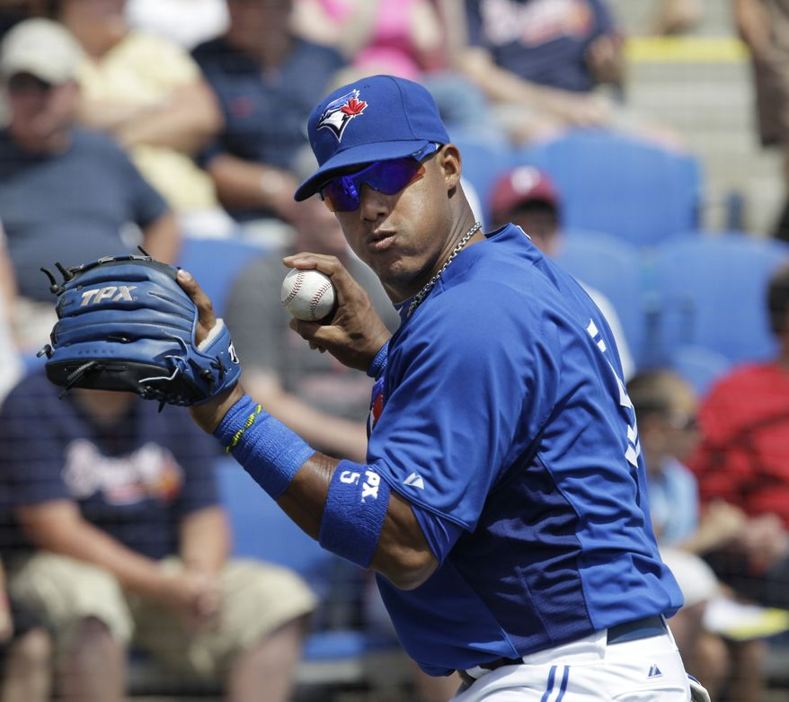 FILE - This March 24, 2012 file photo, shows Toronto Blue Jays shortstop Yunel Escobar warming up before a spring training baseball game against the Atlanta Braves, in Dunedin, Fla. Major League Baseball is checking reports that Escobar played Saturday's, Sept. 15, 2012 game against Boston wearing eye-black displaying a homophobic slur written in Spanish. (AP Photo/Kathy Willens, File)