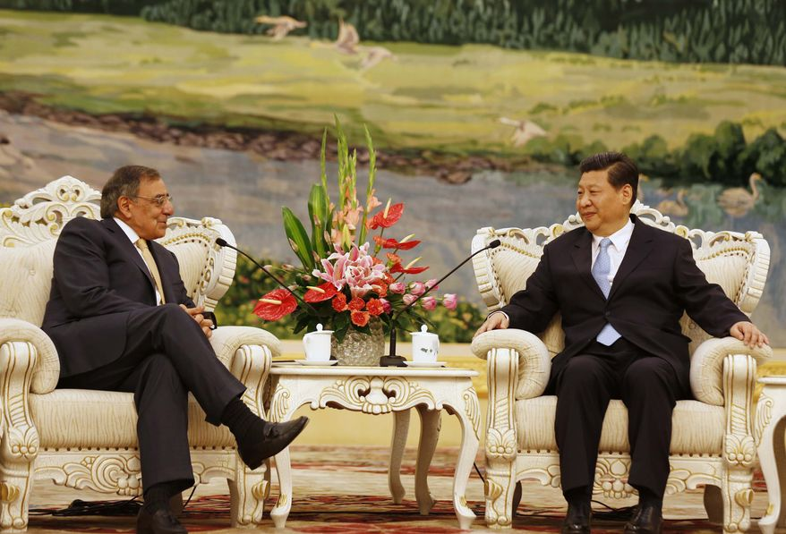 U.S. Defense Secretary Leon Panetta, left, meets with China's Vice President Xi Jinping at the Great Hall of the People in Beijing, China Wednesday, Sept. 19, 2012. Panetta met Wednesday with Chinese leader-in-waiting Xi, who just days ago reappeared after a puzzling two-week disappearance. (AP Photo/Larry Downing, Pool)