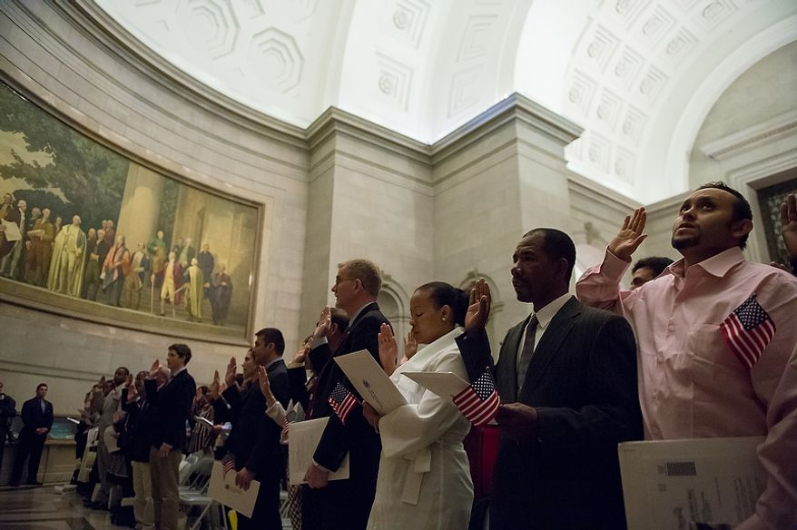 Petitioners are sworn in as U.S. citizens on Sept. 17, 2012, at the National Archives Building in Washington, during a naturalization ceremony to commemorate the 225th anniversary of the signing of the U.S. Constitution. (Andrew Harnik/The Washington Times)