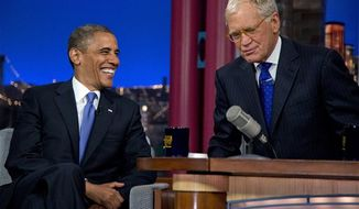 "President Obama talks with David Letterman on the set of the ""Late Show With David Letterman"" at the Ed Sullivan Theater, Tuesday, Sept. 18, 2012, in New York. (AP Photo/Carolyn Kaster)"