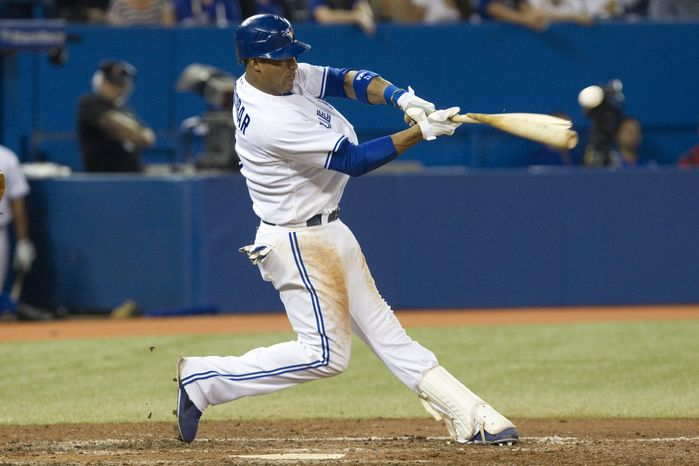 Toronto Blue Jays' Yunel Escobar breaks his bat as he hits a double off a ball from Baltimore Orioles pitcher Miguel Gonzalez during the seventh inning of baseball game action in Toronto, Wednesday, Sept. 5 , 2012. (AP Photo/The Canadian Press, Chris Young)