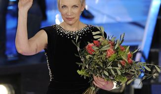 "**FILE** British musician Annie Lennox is seen here on Feb. 21, 2009, during the ""Festival di Sanremo"" Italian song contest in San Remo, Italy. (Associated Press)"