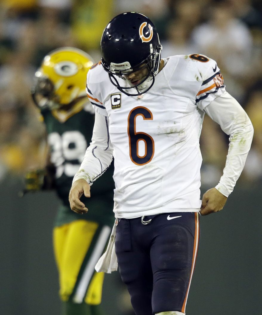 FILE - In this file photo taken Sept. 13, 2012, Chicago Bears quarterback Jay Cutler walks off the field after being sacked during the Bears' 23-10 loss to the Green Bay Packers in an NFL football game in Green Bay, Wis. Cutler didn't get much protection during the game and his leadership got called into question for his sideline tirade against J'Marcus Webb and comments after the Bears' loss. (AP Photo/Jeffrey Phelps, File)
