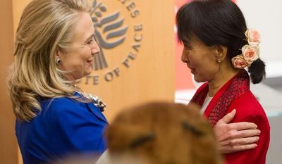 Secretary of State Hillary Rodham Clinton (left) welcomes Myanmar democracy leader Aung San Suu Kyi at the U.S. Institute of Peace in Washington on Tuesday, Sept. 18, 2012. (Andrew Harnik/The Washington Times)