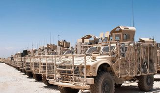 U.S. military vehicles have been placed in a yard at the Kandahar Air Field for shipment back to the United States or other locations as part of a 23,000 reduction in the U.S. troop level by Sept. 30. (Associated Press)