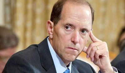 House Ways and Means Committees Chairman Rep. Dave Camp, Michigan Republican, is leading efforts in the House to block the Obama administration from granting waivers to the welfare work requirement. (Associated Press)
